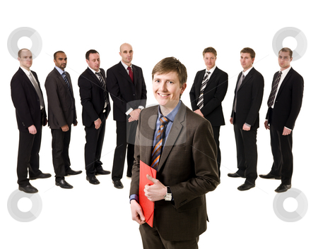 Man with a document stock photo, Man with a document in front of a group of men by Anne-Louise Quarfoth