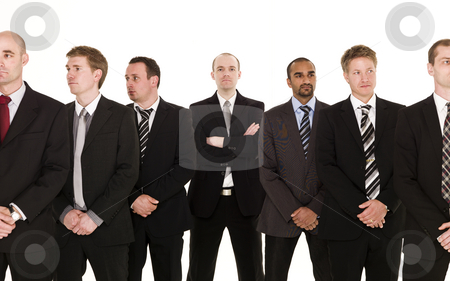 Business team stock photo, Business team with the boss in the middle by Anne-Louise Quarfoth
