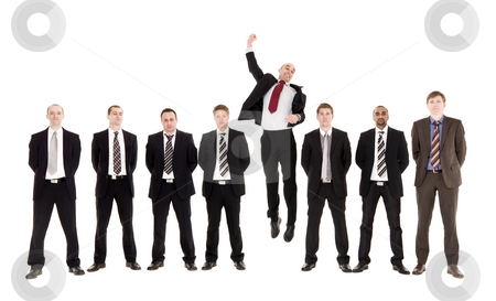 Jumping man in a row with other men stock photo, Jumping man in a row with other men isolated on white background by Anne-Louise Quarfoth
