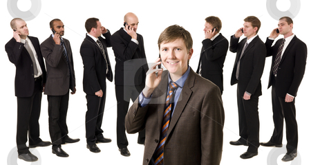 Man on the phone in front of his team stock photo, Business Manager on the phone in front of his team by Anne-Louise Quarfoth