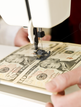 Sewing money stock photo, Ten dollar bank notes in a sewing machine by Anne-Louise Quarfoth