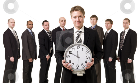 Business manager in front of his team stock photo, Business manager with a clock in front of his team by Anne-Louise Quarfoth