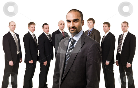 Boss in front of his team stock photo, Boss in front of his team isolated on white background by Anne-Louise Quarfoth