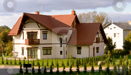 Row of new condos stock photo, Row of attractive newly constructed condos in Sigulda, with red gabled roofs by Tatjana Keisa