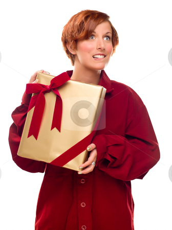 Pretty Red Haired Girl Biting Lip Holding Wrapped Gift stock photo, Pretty Red Haired Girl Biting Her Lip Holding Wrapped Gift Isolated on a White Background. by Andy Dean