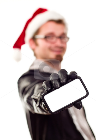 Man with Santa Hat Holding Out Blank Cell Phone stock photo, Smiling Young Man with Santa Hat Holding Out Blank Cell Phone Isolated on a White Background. by Andy Dean