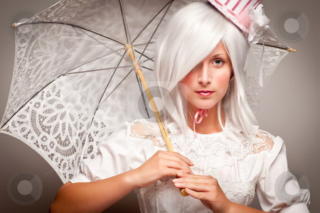 Pretty White Haired Woman with Parasol stock photo, Pretty White Haired Woman Wearing Classic Dress with Parasol and Small Top Hat. by Andy Dean