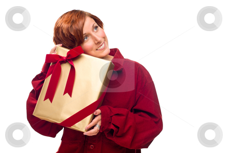 Pretty Red Haired Girl with Wrapped Gift Isolated stock photo, Pretty Red Haired Girl Rests Her Head on a Precious Wrapped Gift Isolated on a White Background. by Andy Dean