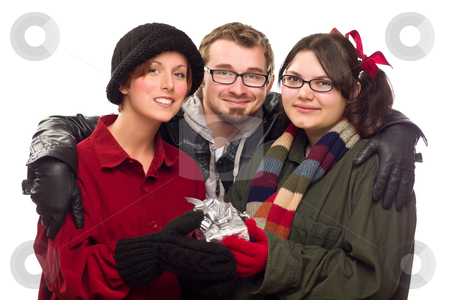 Three Friends Holding A Holiday Gift Isolated stock photo, Three Friends Holding A Holiday Gift Isolated on a White Background. by Andy Dean