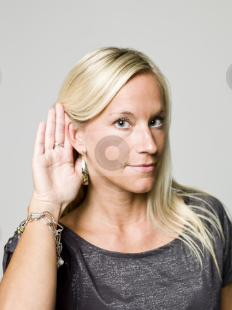 Portrait of a woman listening stock photo, Portrait of a woman listening by Anne-Louise Quarfoth