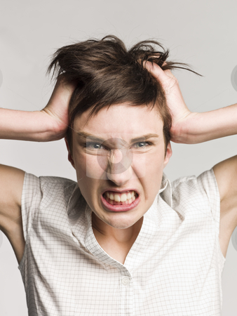 Portrait of an angry woman stock photo, Portrait of an angry woman by Anne-Louise Quarfoth