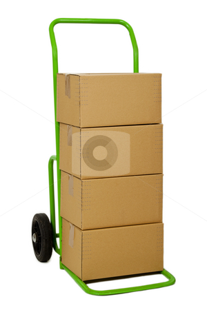 Hand truck with packages stock photo, Green hand truck with four cardboard boxes on it ready for delivery by Birgit Reitz-Hofmann
