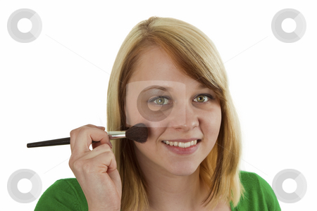 Makeup stock photo, Attractive young woman applying blusher - isolated on white by Birgit Reitz-Hofmann
