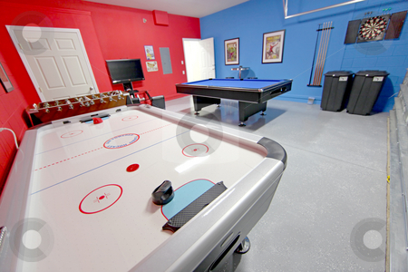 Games Room stock photo, A Games Room with Pool, Air Hockey, Foosball and Dart Board by Lucy Clark