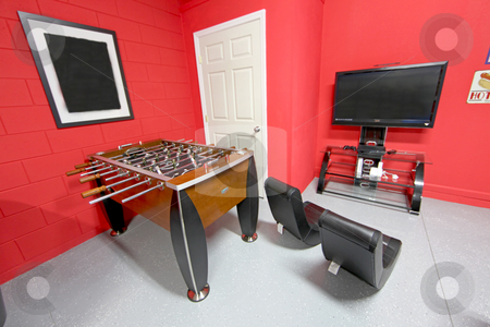 Games Room stock photo, A Games Room with Foosball, TV and Gaming Chairs by Lucy Clark