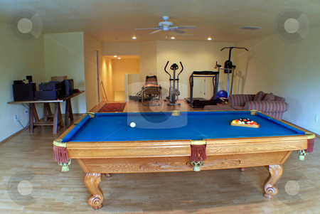 Entertainment Room stock photo, An Interior in a house with Pool Table and Fitness Equipment by Lucy Clark
