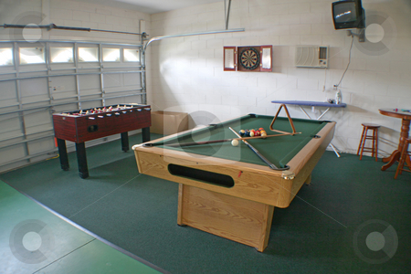 Games Room stock photo, A Games Room with Pool Table, Foosball and Darts Board. by Lucy Clark