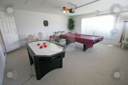 Games Room stock photo, A Games Room with Pool Table and Air Hockey Table. by Lucy Clark