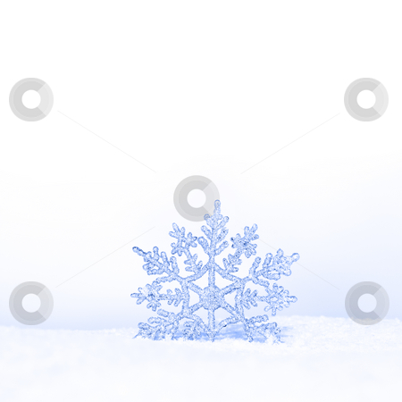Beautiful snowflake stock photo, Beautiful silver snowflake in snow by Viktor Thaut