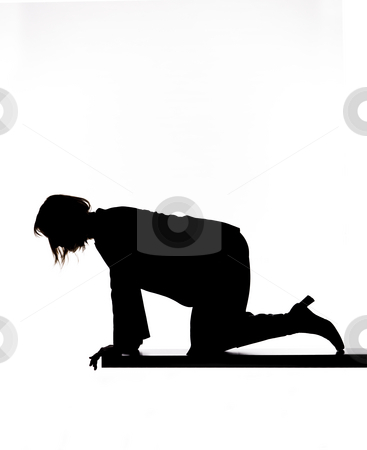 Silhouette of a woman looking down stock photo, Silhouette of a woman looking down by Anne-Louise Quarfoth