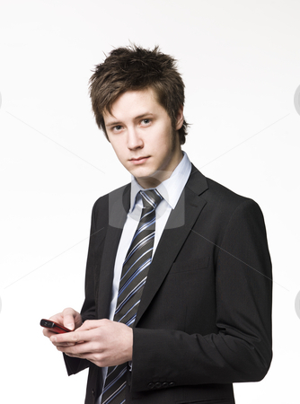 Businessman with a cell-phone stock photo, Businessman with a cell-phone by Anne-Louise Quarfoth