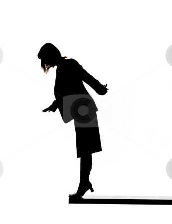 Silhouette of a woman on the edge stock photo, Silhouette of a woman on the edge by Anne-Louise Quarfoth