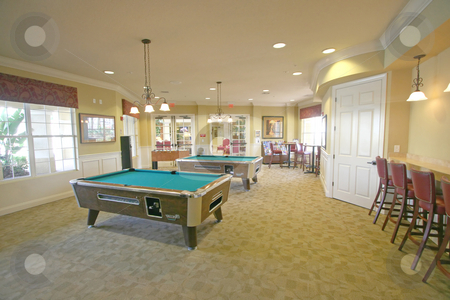 Games Room stock photo, A games room with pool tables and bar stools. by Lucy Clark