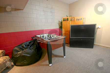 Games Room stock photo, A Games Room with Foosball Table and TV by Lucy Clark