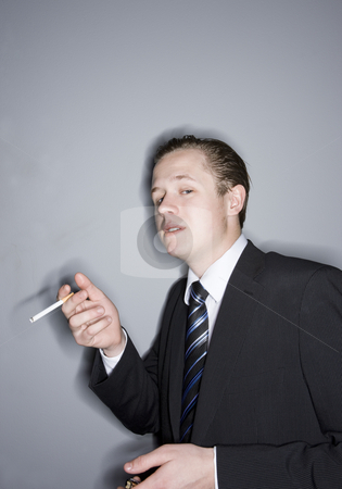 Young man smoking stock photo, Young man smoking by Anne-Louise Quarfoth