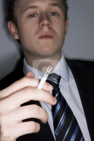 Young man and a cigarette stock photo, Young man and a cigarette by Anne-Louise Quarfoth
