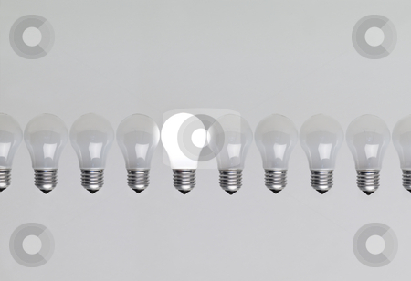 Row of light bulbs stock photo, Row of light bulbs by Anne-Louise Quarfoth