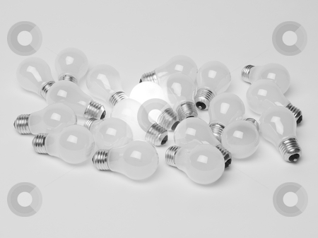 Pile of light bulbs stock photo, Pile of light bulbs by Anne-Louise Quarfoth