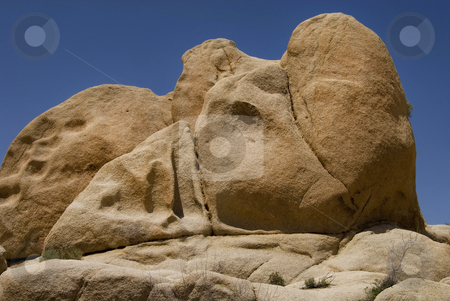 Rhino Rock stock photo, The rock on the right looks like a rhino's horn. The desert landscape of Joshua Tree National Park, California. by Mary Lane