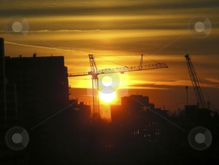 Setting Sun stock photo, A bright orange setting sun, against an urban landscape by Mary Lane