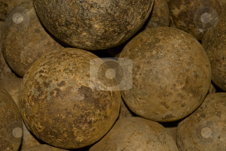 Cannon Balls stock photo, A pile of rusty cannon balls, at the historic French fort of Louisburg, Nova Scotia, Canada. by Mary Lane
