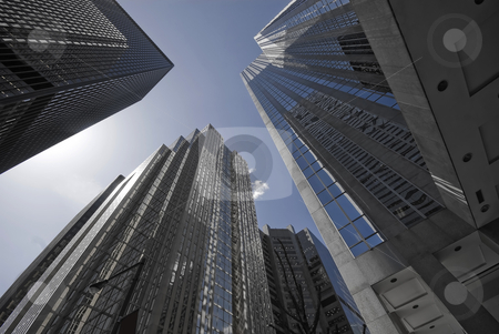 Blue Grey Offices stock photo, A group of soaring office towers, shaded in blue and grey. by Mary Lane