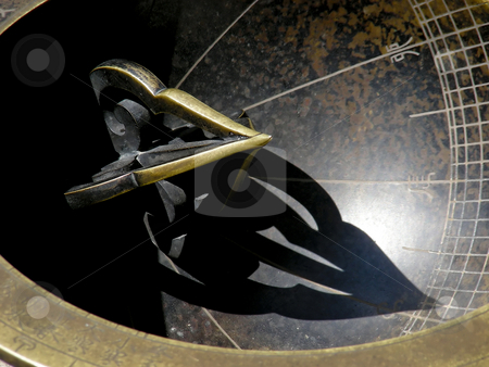 Sundial stock photo, The gnomen of a sundial, on the grounds of a palace in Seoul, Korea. by Mary Lane