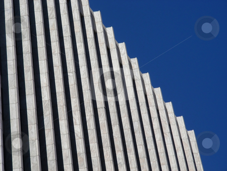 Black and White stock photo, A repeating pattern of black and white columns against a blue sky. by Mary Lane