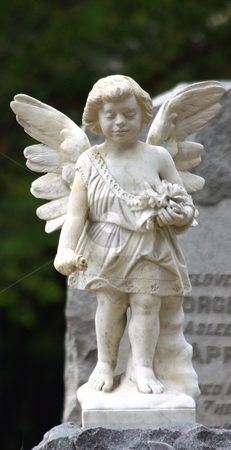 Cherub stock photo, Cherub with wings in front of tombstone after thunderstorm by Marburg
