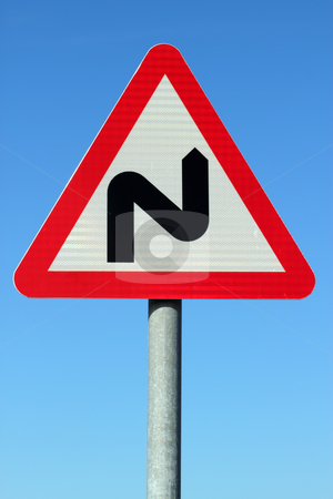 British double bend road sign and blue sky. stock photo, British double bend road sign and blue sky. by Stephen Rees