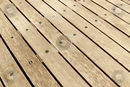 Weathered large wooden decking planks close up. stock photo, Weathered large wooden decking planks close up. by Stephen Rees