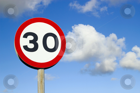 British 30 miles an hour speed limit sign. stock photo, British 30 miles an hour speed limit sign. by Stephen Rees