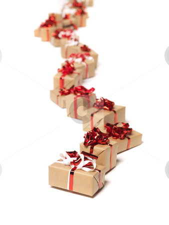 Christmas gifts in a row stock photo, Christmas gifts in a row by Anne-Louise Quarfoth