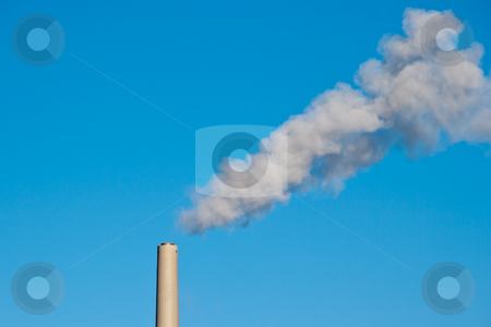 Chimney with smoke trail stock photo, Smoke from coal power plant chimney against blue sky. Symbol of global warming and smoke pollution. by Gert Lavsen