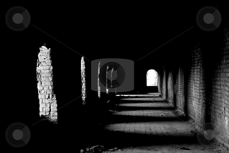 Old dark passage stock photo, An old dark passage with the light coming from the arches by Dario Rota