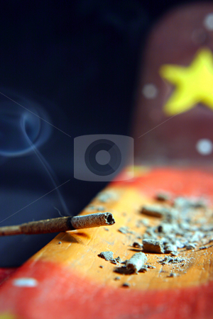 Burning incense stock photo, The incense is burning and spirals of smoke flutter in the air while the ashes stands on the incense boat by Dario Rota