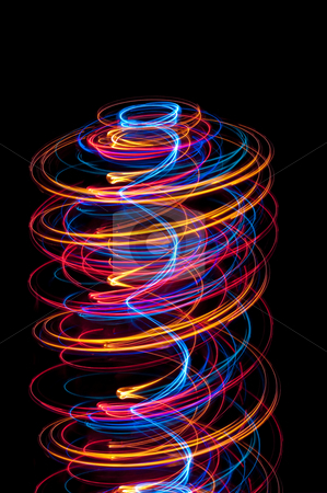 Light spiral stock photo, Abstract helter skelter composed of spirals of glowing light by Stephen Gibson