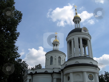 White orthodox church stock photo, White beautiful church in Moscow near the center of the city by Vladislav Chekanin