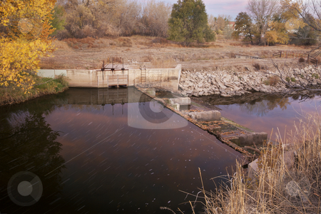 Water flowing into irrigation ditch stock photo, Diversion dam with water flowing into irrigation ditch inlet, Cache la Poudre River at Fort Collins, Colorado, fall scenery at dawn by Marek Uliasz