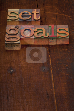 Set goals stock photo, Set goals - text in vintage wooden letterpress printing blocks against old grunge wooden background by Marek Uliasz